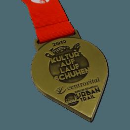 Kultur auf Laufschuhen medaille